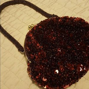 Caché- Small Sequined Wristlet